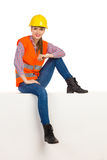 Relaxed Female Construction Worker Sitting Royalty Free Stock Image