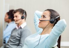 Relaxed Female Customer Service Representative Stock Photo