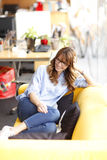 Relaxed female executive in office Stock Images