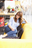 Relaxed female executive in office Royalty Free Stock Image