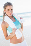 Relaxed fit blonde in sportswear holding towel Stock Image