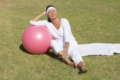 Relaxed fit and sporty senior woman outdoor Stock Image
