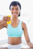 Relaxed fit woman enjoying a glass of orange juice Royalty Free Stock Photos