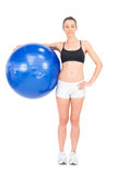 Relaxed fit woman holding exercise ball Stock Photo