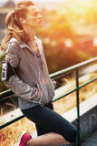 Relaxed fitness woman in city in the evening Royalty Free Stock Photos