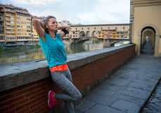 Relaxed fitness woman in front of ponte vecchio Royalty Free Stock Photo