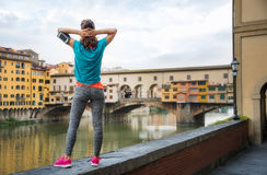 Relaxed fitness woman standing in front of Ponte Vecchio Royalty Free Stock Image