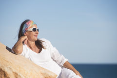 Relaxed friendly mature woman at beach vacation Royalty Free Stock Photos