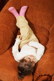 Relaxed girl in big chair Royalty Free Stock Photos