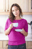Relaxed girl with cup of tea Royalty Free Stock Photography