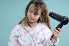 Relaxed girl drying hair Stock Photography