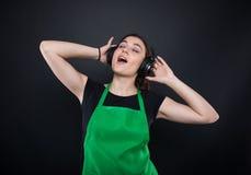 Relaxed girl employee enjoying music on headphones Royalty Free Stock Photos