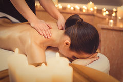 Relaxed girl getting massage at spa Royalty Free Stock Photo