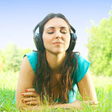 Relaxed girl with headphones Stock Photos