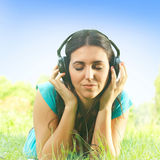 Relaxed girl with headphones Royalty Free Stock Photography