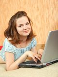 Relaxed girl with laptop Royalty Free Stock Image