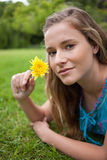 Relaxed girl lying on the grass in a park Stock Photo