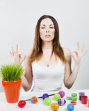 Relaxed girl and painted eggs. Woman meditating with easter eggs and green grass Stock Image