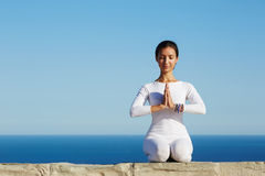 Relaxed girl performing yoga routine Royalty Free Stock Photo