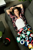 Relaxed girl resting on the sofa at home. Stock Photos