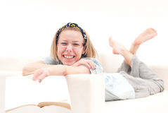 Relaxed girl, on the sofa, smiling Stock Photos