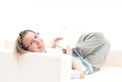 Relaxed girl, on the sofa, smiling Royalty Free Stock Photos