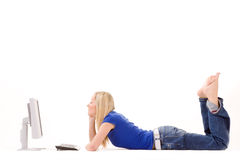 Relaxed girl using computer Royalty Free Stock Photography