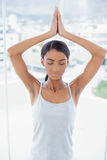 Relaxed gorgeous model doing yoga exercise Stock Photography