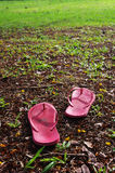 Relaxed on grass field. A pair of slippers are left on field of a relaxed day Stock Images