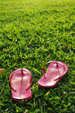 Relaxed on grass field. A pair of slippers are left on field of a relaxed day Royalty Free Stock Photography