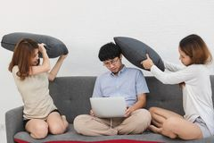 Relaxed group of Asian friends having fun together in living room.  stock images
