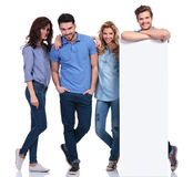 Relaxed group of people showing a blank board Royalty Free Stock Images