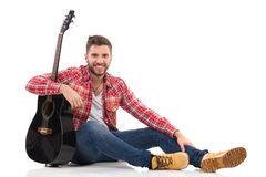 Relaxed guitarist Royalty Free Stock Photos