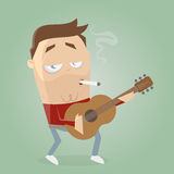 Relaxed guitarist smoking a cigarette Stock Photos