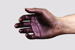 Relaxed Hand with purple Paint on Skin stock images