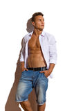 Relaxed Handsome Man In White Unbuttoned Shirt Looking Away Stock Photography