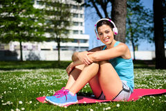 Relaxed happy fitness woman resting Stock Photo