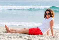 Relaxed And Happy Lady On The Beach Royalty Free Stock Photography