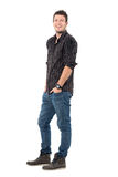 Relaxed happy laughing young man wearing jeans and plaid shirt Royalty Free Stock Images