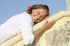 Relaxed happy mature woman outdoor wall Royalty Free Stock Photography
