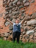 Relaxed happy mature woman outdoor wall Royalty Free Stock Images