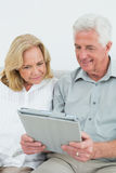 Relaxed happy senior couple using digital tablet Stock Photography