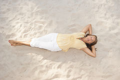 Relaxed happy senior woman at beach Royalty Free Stock Photos