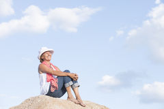 Relaxed happy smiling woman on top of mountain Stock Photography