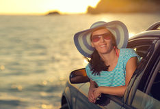 Relaxed happy woman on summer roadtrip travel vacation Stock Photos