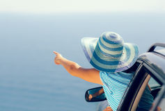 Relaxed happy woman on summer roadtrip travel vacation Stock Images