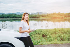 Relaxed happy woman traveler on summer roadtrip vacation on hatc Royalty Free Stock Images