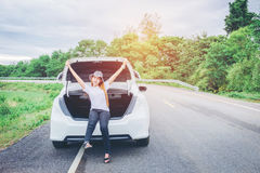 Relaxed happy woman traveler on summer roadtrip vacation on hatc Stock Photos