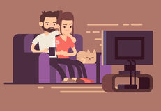 Relaxed happy young couple watching tv at home in living room Stock Image