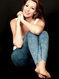 Relaxed Happy Young Woman Sitting on Floor Stock Photo